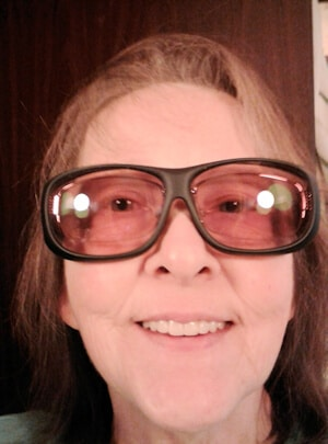 Wearing Axon Optics Indoor Therapeutic Glasses